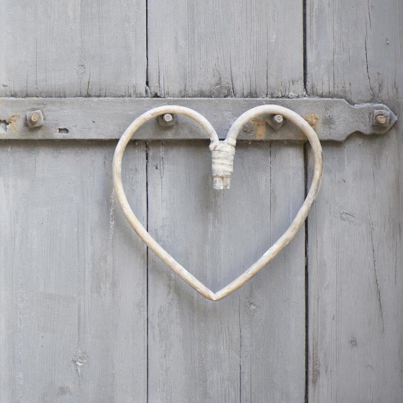 Hjerte bøjet af pil - fra Ib Laursen